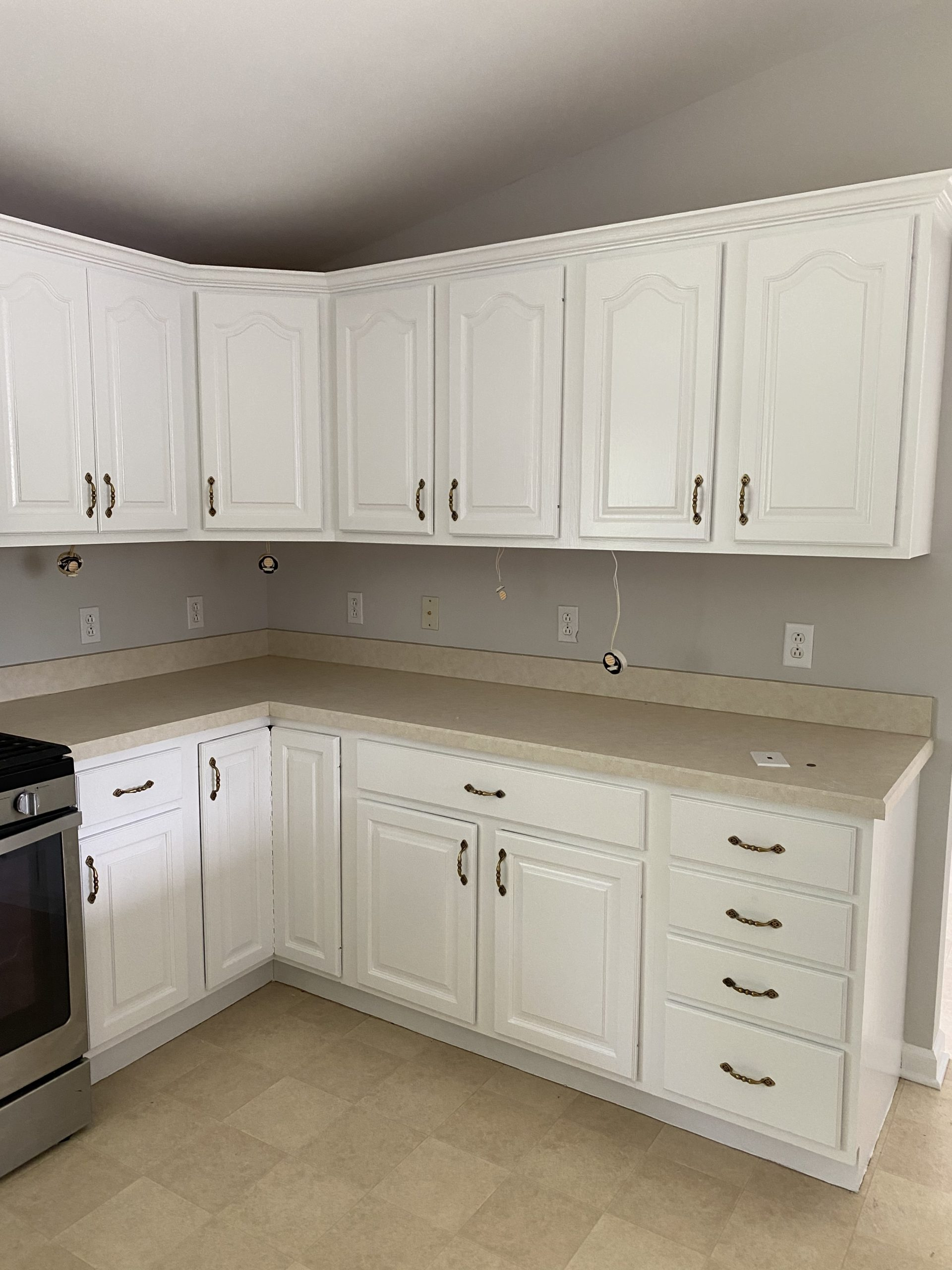 DDS Paints Cabinets at Calvary Hill Church Apartment